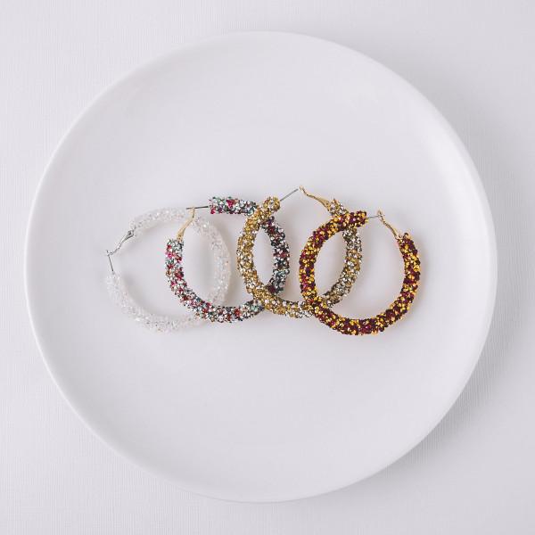 """Large hoop earrings featuring white rhinestones. Approximately 2"""" in diameter."""