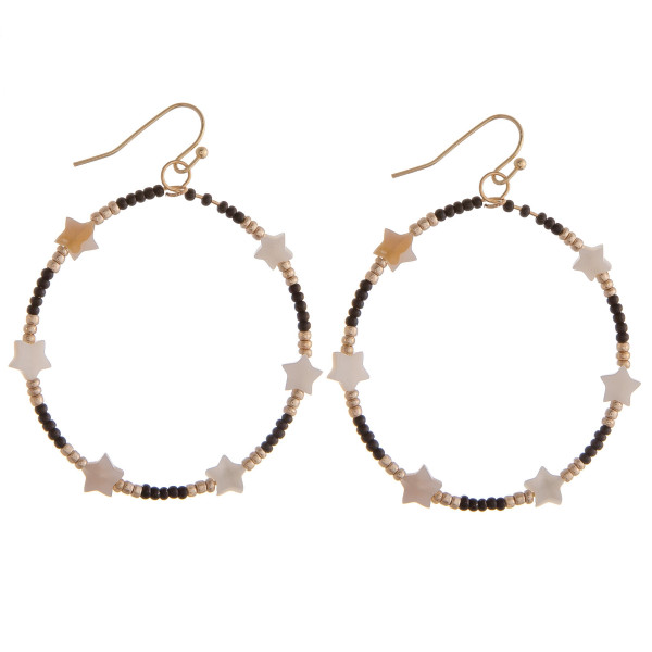 "Circular drop earrings featuring black beads and star accents. Approximately 1.5"" in diameter."