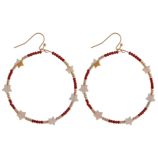 "Circular drop earrings featuring red beads and star accents. Approximately 1.5"" in diameter."