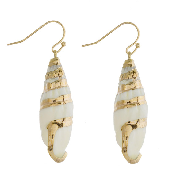 "Long ivory seashell inspired drop earrings featuring gold accents. Approximately 2"" in length."