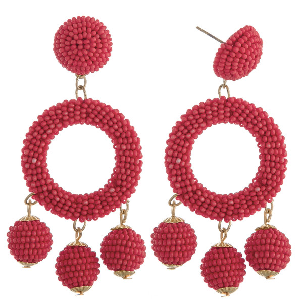 "Coral circular drop earrings featuring hanging beaded accents with a stud post. Approximately 2.5"" in length."