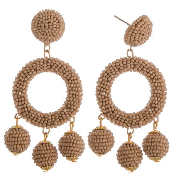 """Natural circular drop earrings featuring hanging beaded accents with a stud post. Approximately 2.5"""" in length."""