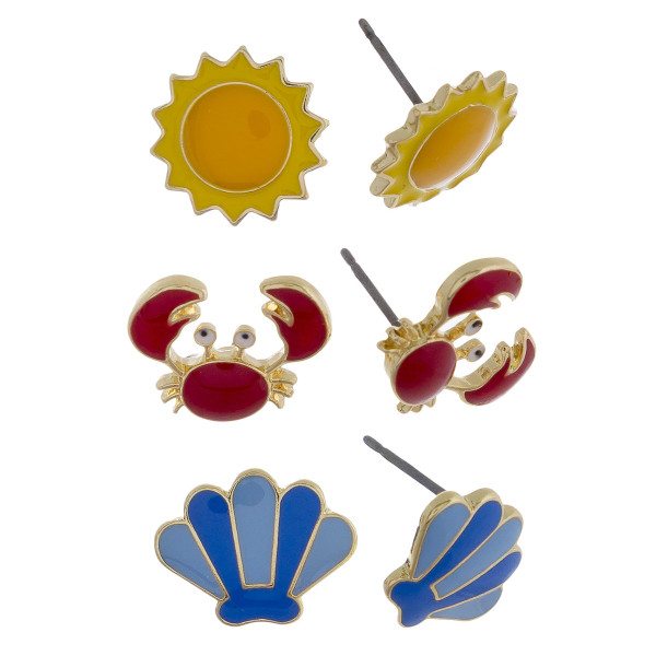 Three-pair stud earrings with sun, crab, and shell details. Approximate 1cm in length.