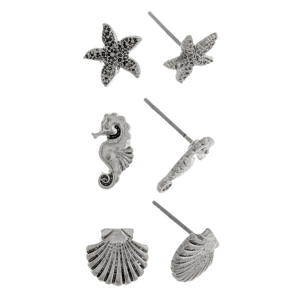 Three-pair stud earrings with starfish, sea horse, and shell details. Approximate 1cm in length.