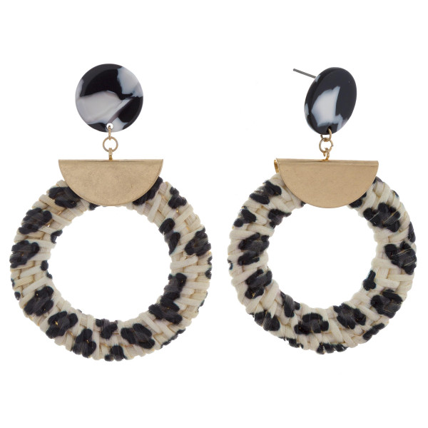 "Long hoop straw earrings with acetate post and animal print details. Approximate 2"" in length."