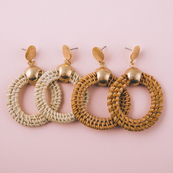 """Rattan braided drop earrings featuring gold accents. Approximately 3"""" in length."""