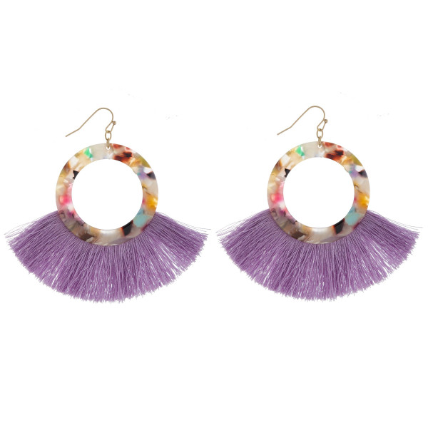 "Circular resin inspired earrings featuring tassel details. Approximately 3"" in diameter."