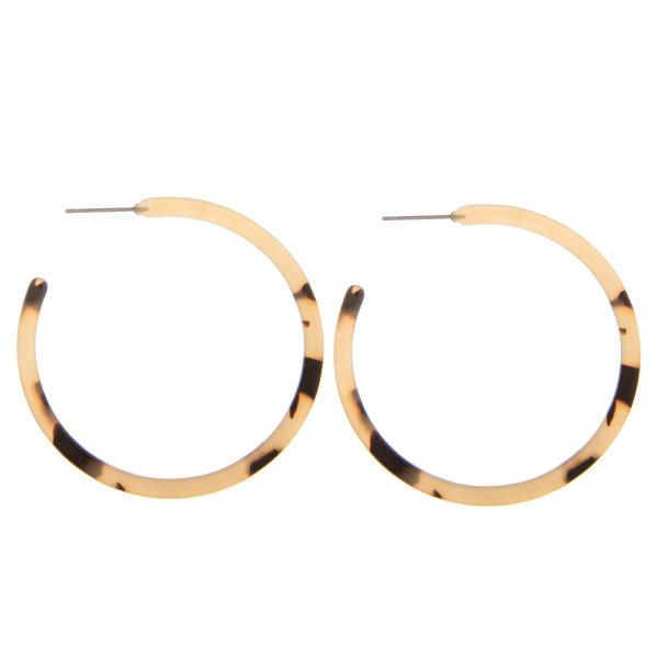 "Long tortoise resin open hoop earrings. Approximate 2"" in length."