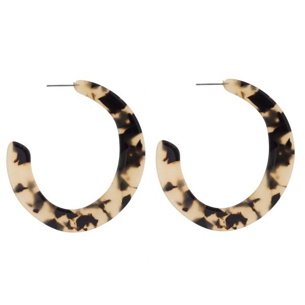 """Long tortoise acetate hoop earrings. Approximate 2.5"""" in length."""