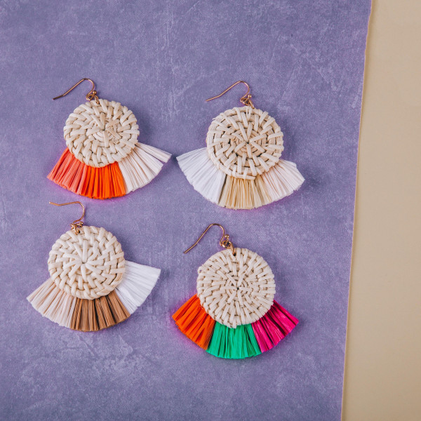 """Long round straw earrings with raffia tassel. Approximate 2"""" in length."""