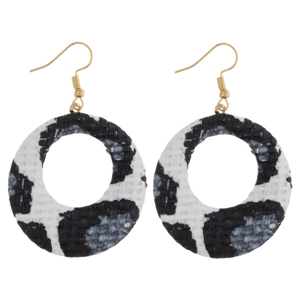 "Circular drop earrings featuring a white animal print raffia pattern. Approximately 1.5"" in diameter."