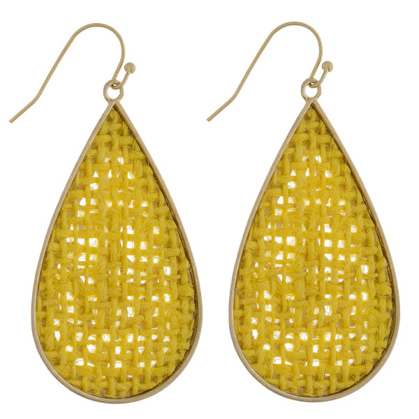 "Long metal drop earring with raffia paper details. Approximate 2"" in length."