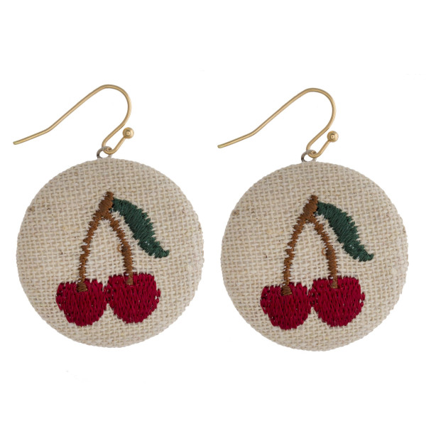 "Raffia circular drop earrings featuring a cherry embroidered detail. Approximately 1"" in diameter."