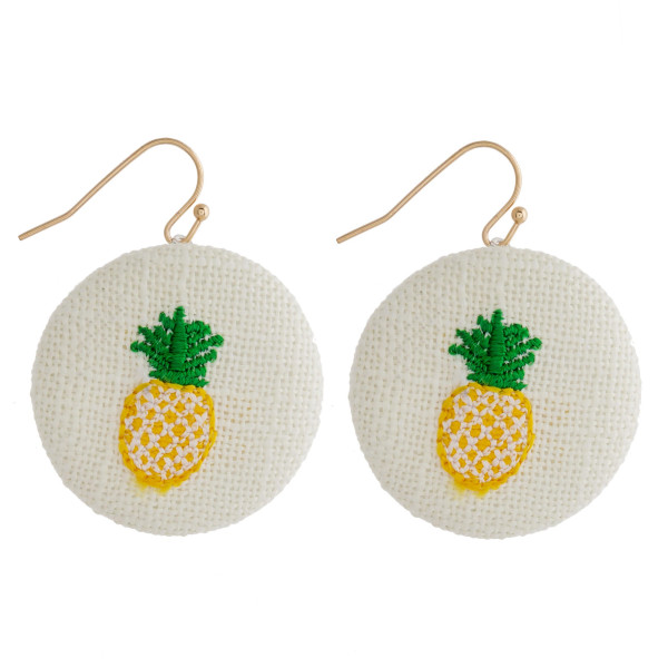 "Raffia circular drop earrings featuring a pineapple embroidered detail. Approximately 1"" in diameter."