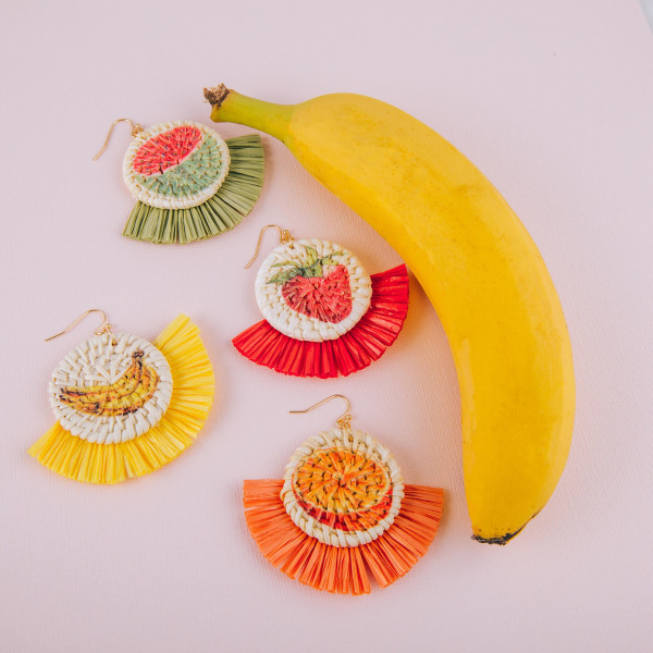 "Long round straw earrings with raffia tassel and fruit print. Approximately 2.5"" in length."