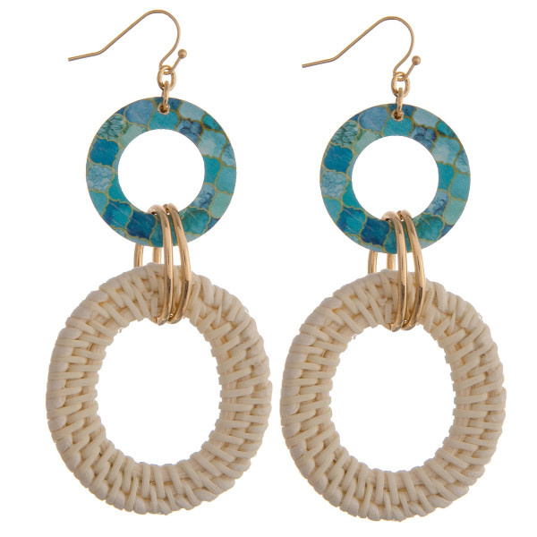 "Rattan woven circular drop earrings featuring a mint pattern and gold accents. Approximately 3"" in length."