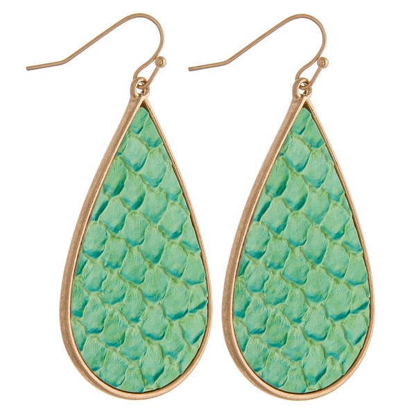 """Teardrop earrings featuring faux leather animal print details. Approximately 2"""" in length."""