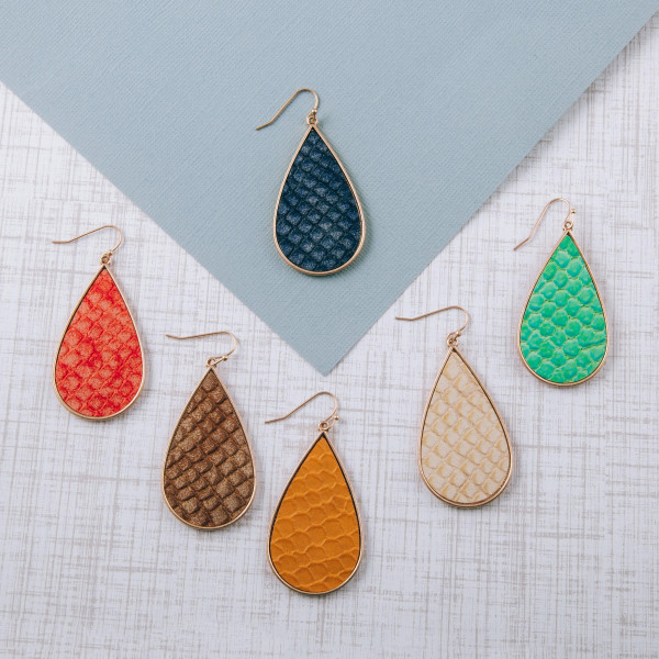 """Teardrop earrings featuring a mermaid scale inspired faux leather centered detail. Approximately 2"""" in length."""