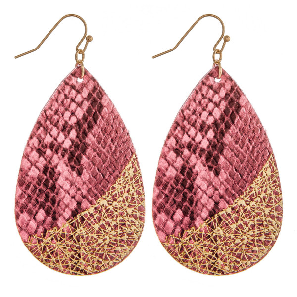 "Faux leather teardrop earrings featuring snakeskin and metallic details. Approximately 2.5"" in length."