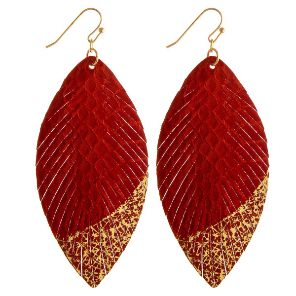 """Faux leather feather inspired earrings featuring snakeskin and metallic details. Approximately 3"""" in length."""