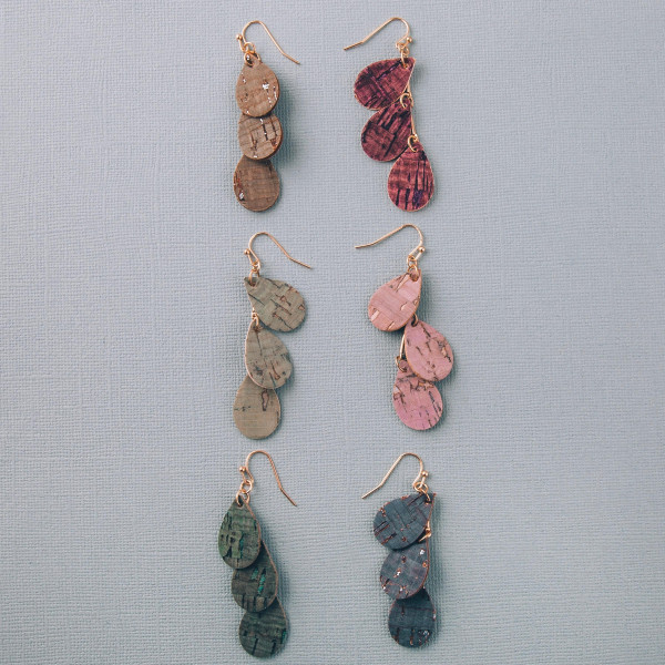 "Long drop earrings featuring a trio teardrop hanging accent with cork inspired details. Approximately 2"" in length."