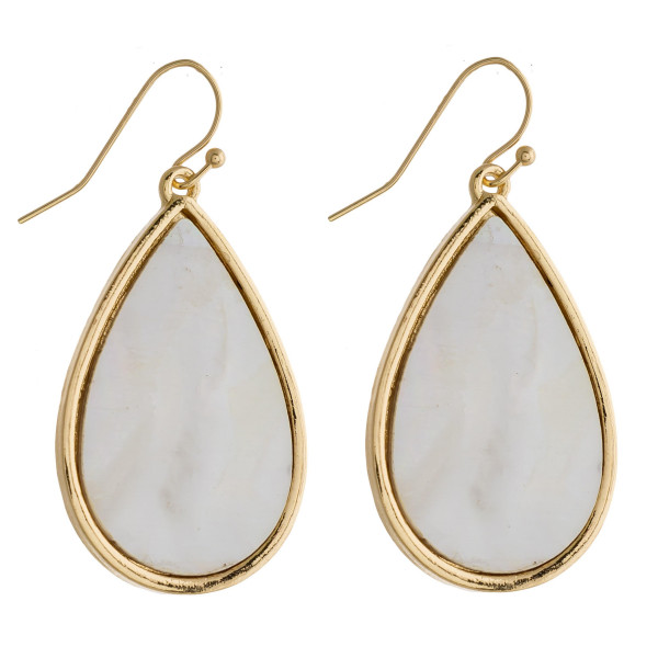 "Teardrop earrings featuring mother of pearl. Approximately 1.5"" in length."