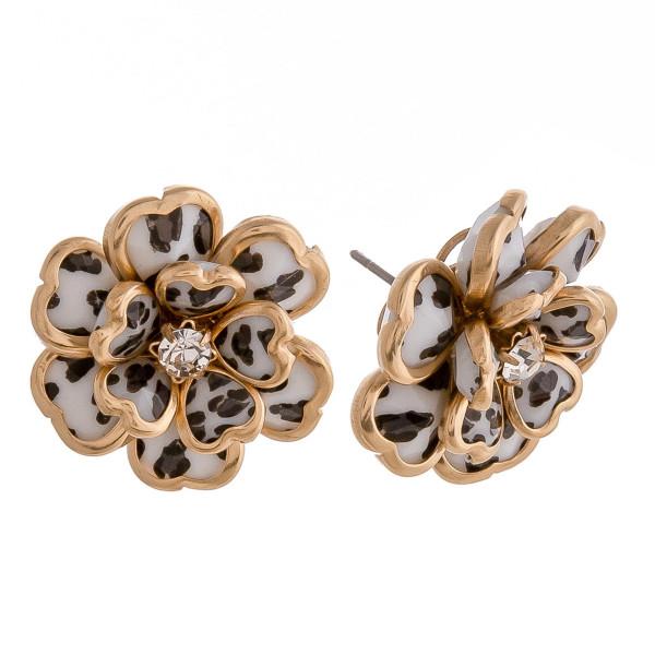 "Leopard print metal flower stud earrings featuring a rhinestone center detail. Approximately 1"" in diameter."