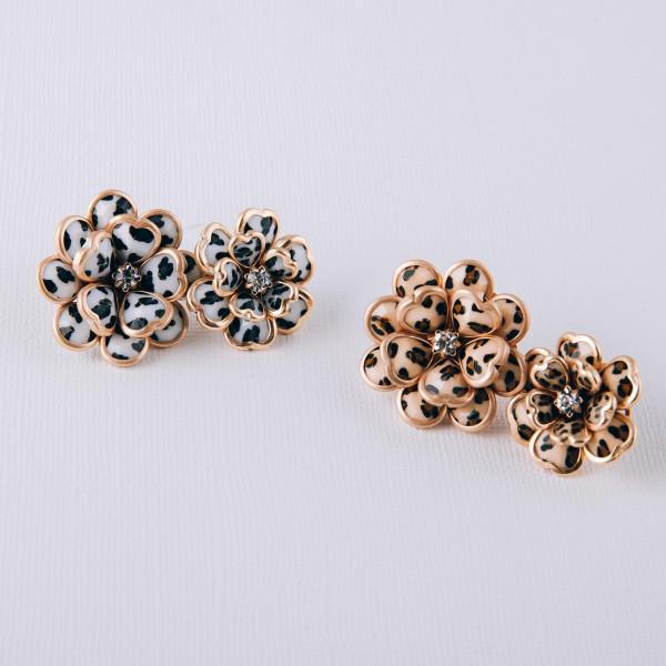 "Leopard print metal flower stud earrings featuring a rhinestone center detail. Approximately .75"" in diameter."