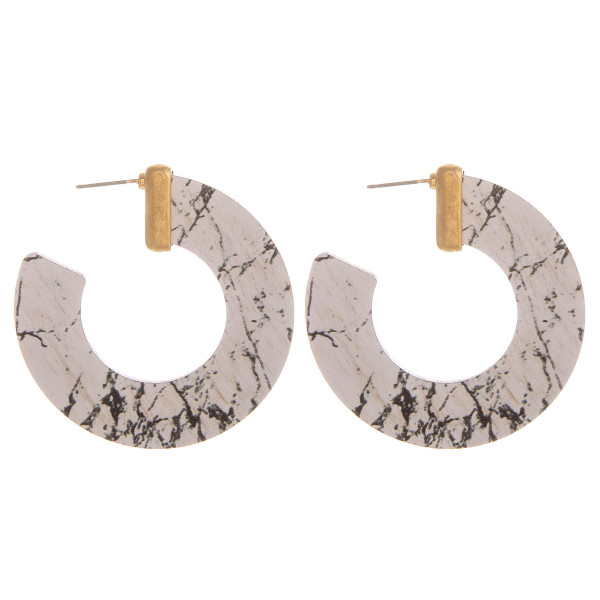 """Large hoop earrings featuring howlite inspired wood details and gold accents. Approximately 1.5"""" in diameter."""