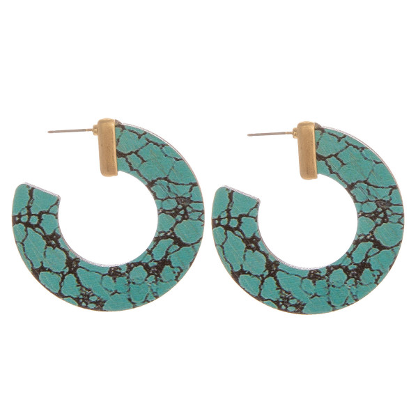 """Large hoop earrings featuring turquoise inspired wood details and gold accents. Approximately 1.5"""" in diameter."""