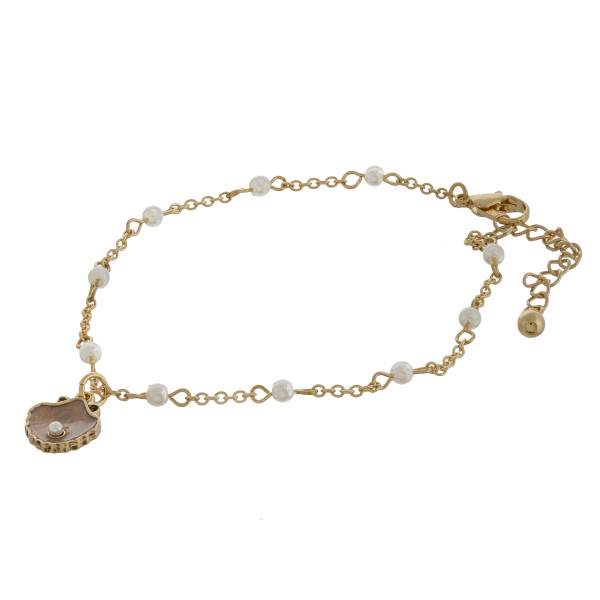 """Open clam charm anklets with pearls and adjustability for the perfect fit. Approximate 12"""" in length."""
