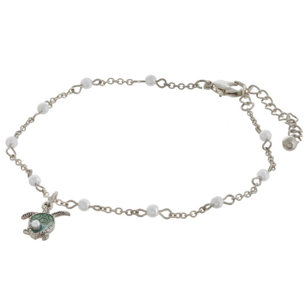 """Metal chain anklet featuring a turtle charm and pearl accents. Approximately 4"""" in diameter with a 2"""" extender."""