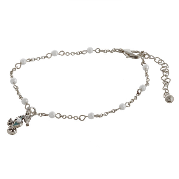 """Metal chain anklet featuring a seahorse charm and pearl accents. Approximately 4"""" in diameter with a 2"""" extender."""