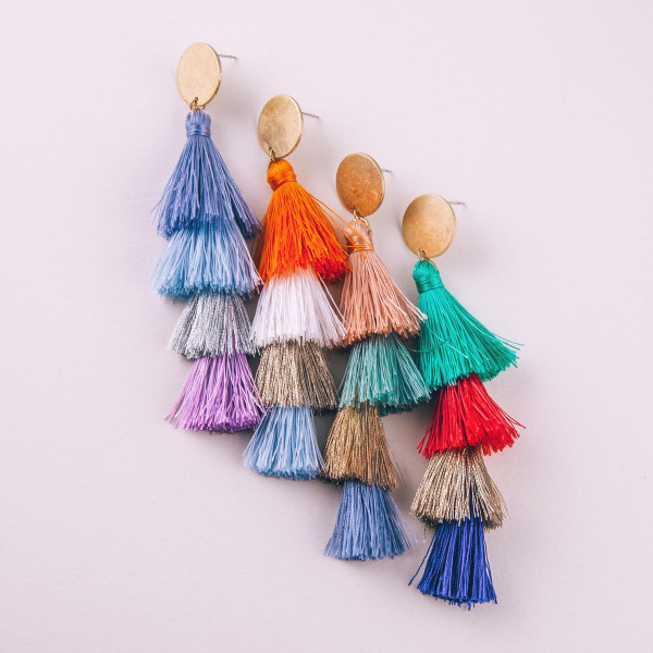 "Long drop earrings featuring fanned tassel details with a stud post. Approximately 3.75"" in length."