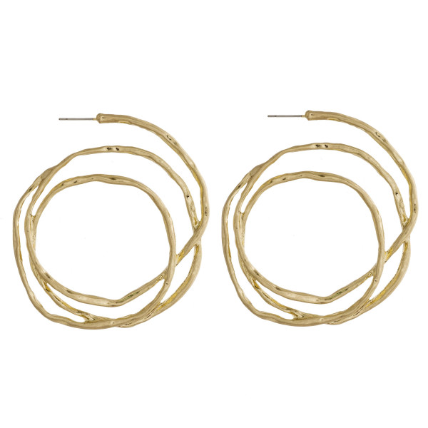 """Large circular metal earrings featuring a stud post. Approximately 2.5"""" in diameter."""