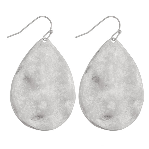 """Silver metal teardrop earrings featuring a hammered texture. Approximately 1.5"""" in in length."""