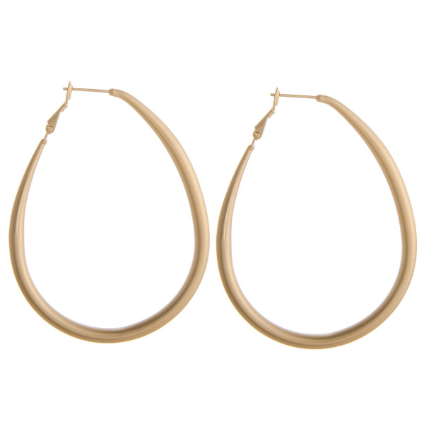 "Gold metal teardrop hoop earrings. Measure approximately 2.5"" in length."