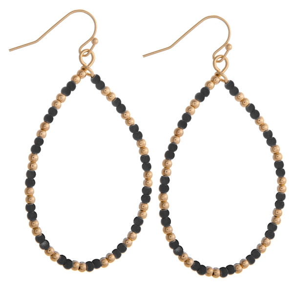 """Black beaded teardrop earrings featuring gold accents. Measures approximately 2"""" in diameter."""