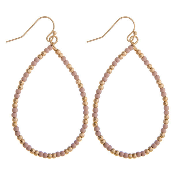 """Nude beaded teardrop earrings featuring gold accents. Measures approximately 2"""" in diameter."""