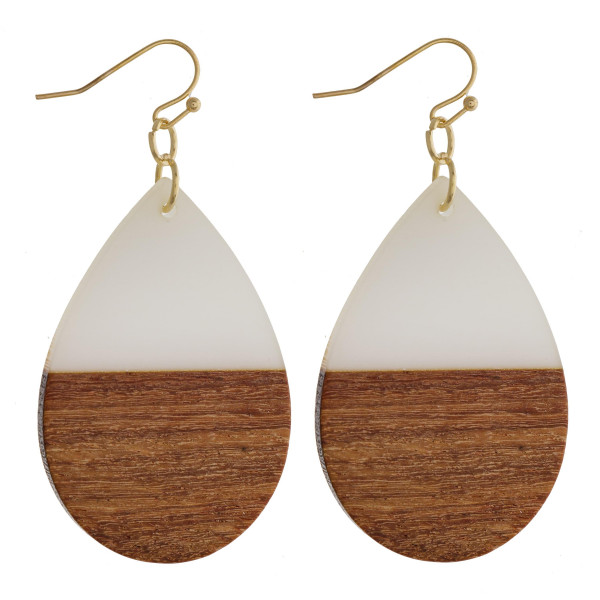 "Teardrop earrings featuring white resin and wood accents. Approximately 1.5"" in length."