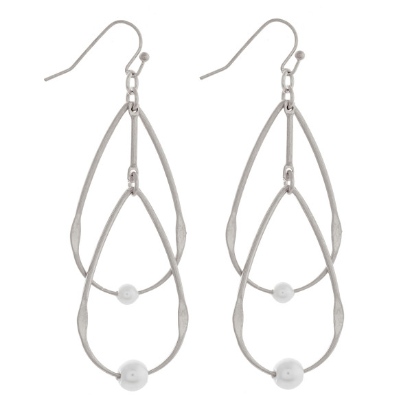 "Double metal teardrop earrings featuring pearl accents. Approximately 2.5"" in length."