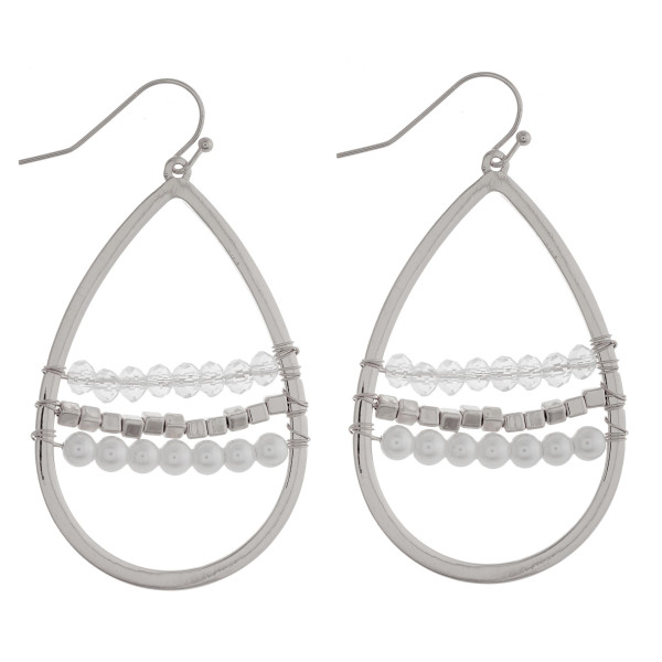 """Metal teardrop earrings featuring beaded and pearl centered details. Approximately 1.75"""" in length."""