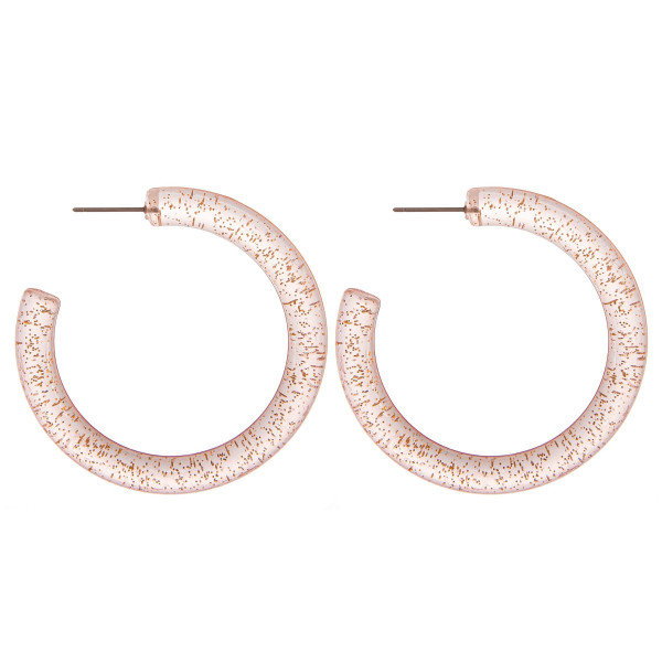 "Clear hoop earrings with gold glitter accents. Measures approximately 2"" in diameter."