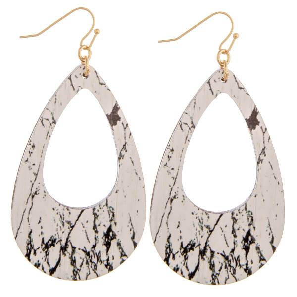 """Wood teardrop earrings featuring a howlite stone inspired pattern. Measure approximately 2.5"""" in length."""