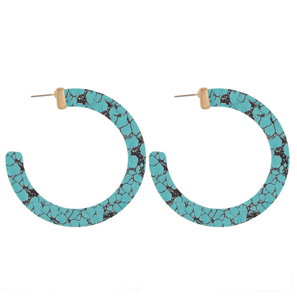 "Wood hoop earrings featuring a veined turquoise inspired pattern. Measure approximately 2.5"" in diameter."