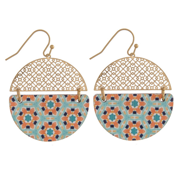 "Circular earrings featuring a filigree inspired pattern with a wood colored accent. Approximately 1"" in diameter."
