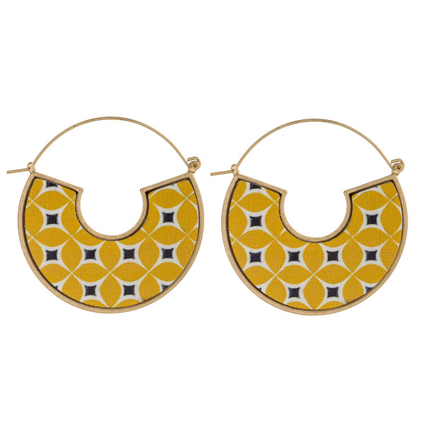 """Metal hoop earrings featuring a wood inspired pattern accent. Approximately 2"""" in diameter."""