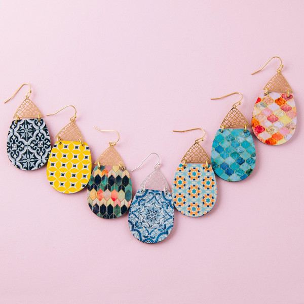 """Wood inspired teardrop earrings featuring a detailed pattern and a filigree accent. Approximately 2"""" in length."""