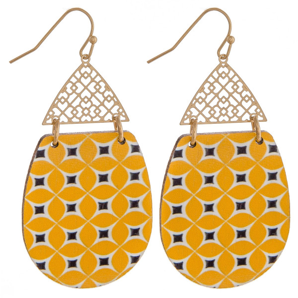 "Wood inspired teardrop earrings featuring a detailed pattern and a filigree accent. Approximately 2"" in length."
