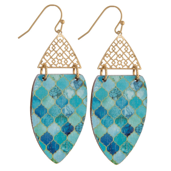 """Long drop earrings featuring a filigree inspired pattern and a wood colored accent. Approximately 2"""" in length."""
